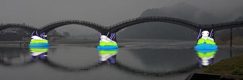 錦帯橋でのプロジェクションマッピング実施イメージ。岩国ゆかりの白蛇を投影したところ(資料:宮崎しずか、最先端表現技術利用推進協会)