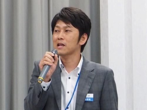 講演する技術部空間情報事業課3Dチーム主任の田嶋誠司氏(写真:家入龍太)