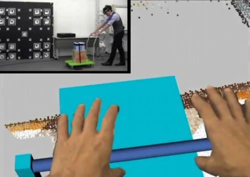 すると、目の前には仮想の台車が現れ、自分の手で取っ手を握ることができる