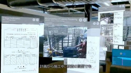 現場に様々な書類や工事写真などを表示して検査を行っているイメージ