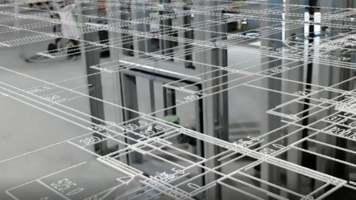 HoloLensで現場を見たところ。現場の床に実寸大の図面を広げたように見える(資料:インフォマティクス)
