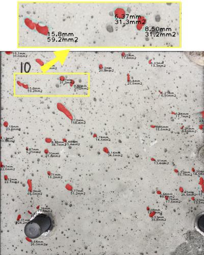 コンクリートの空げきをAIで自動検出し、着色した写真。ミリ単位で寸法や面積も自動算出されている