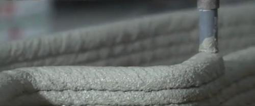 モルタル状の材料を吹き出しながら造形するノズル