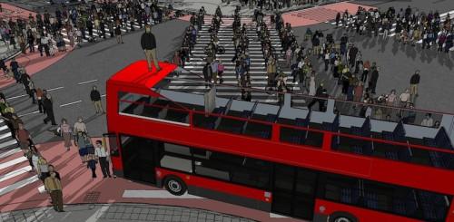 「整然と列をなす歩行者に、『だんじり』のように人が立った二階建てバスが突っ込む」ようなシーンのイメージ(以下の資料:足利市映像のまち推進課ホームページより)