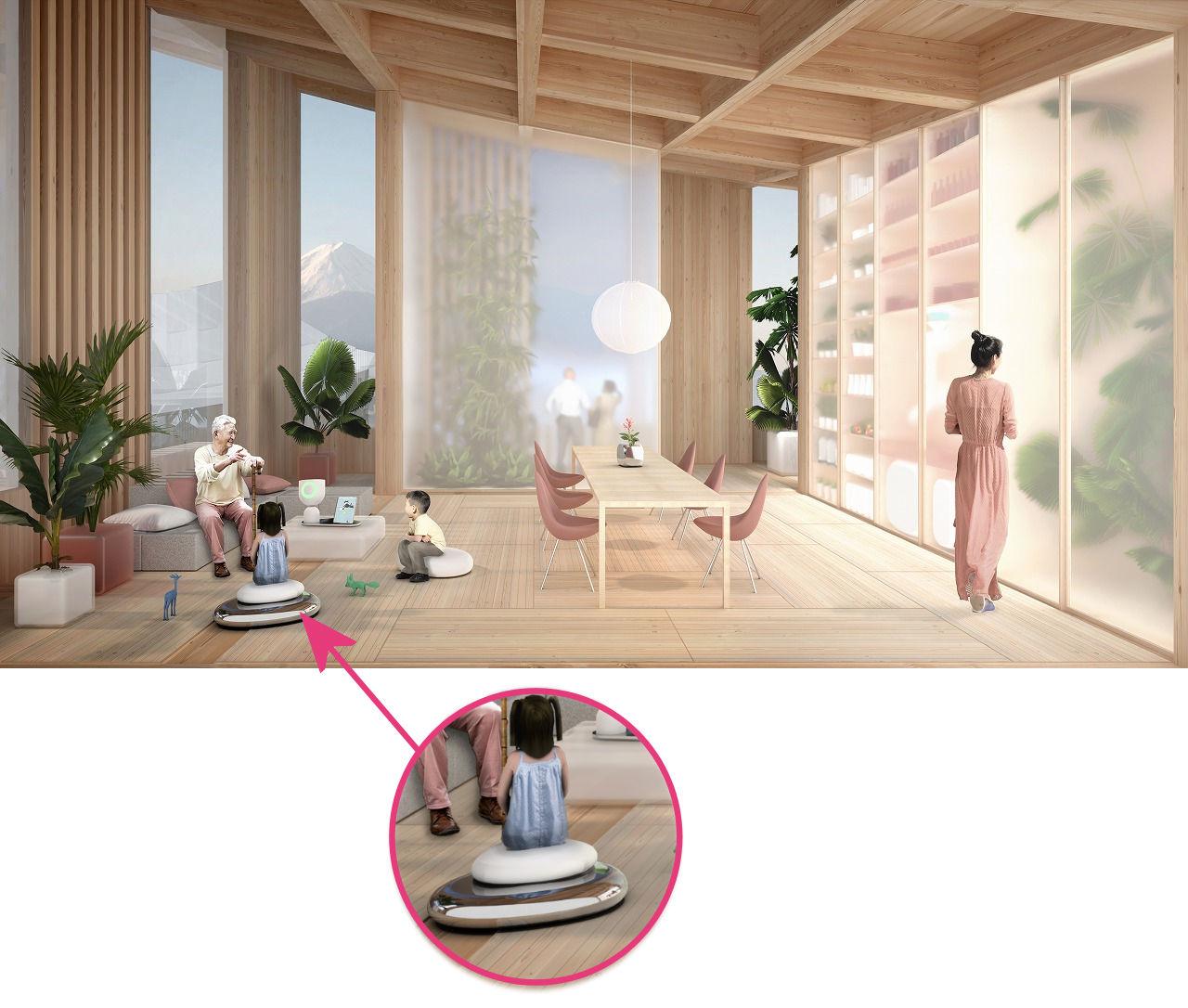 """家族団らんのシーンに登場する""""動く座布団""""らしきもの。室内のモビリティーの進化について、想像は膨らみます"""