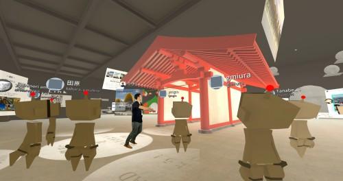 展示会場での一コマ。ARCHICADで作られた寺社建築のBIMモデル前に集まり、説明を聞く参加者たち