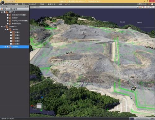 造成現場の完成形状(緑色の線)と現場の色付き点群データを重ね合わせて見たところ。工事の進捗をわかりやすく表現できる